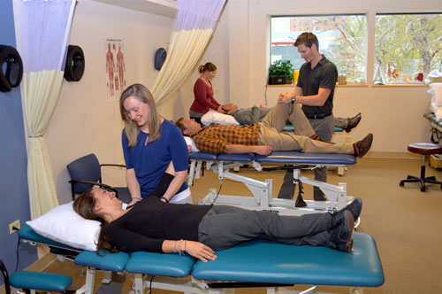 Image: Atlas Physical Therapy in Denver Uptown - Physical Therapist with patients