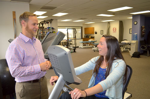Image: Physical Therapy in Stapleton Area - Physical Therapist Alex Lanton with patient