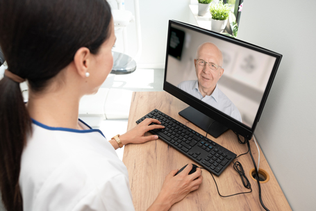 Telehealth appointment with doctor and patient viewing each other on computer screen